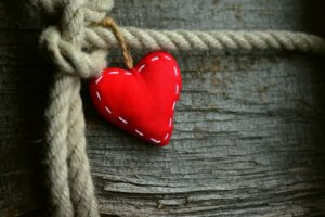 Red heart tied to rope - showing connection