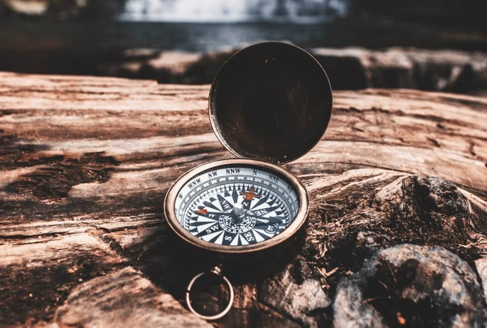 Brown compass on wood - finding yourself Ad Florem