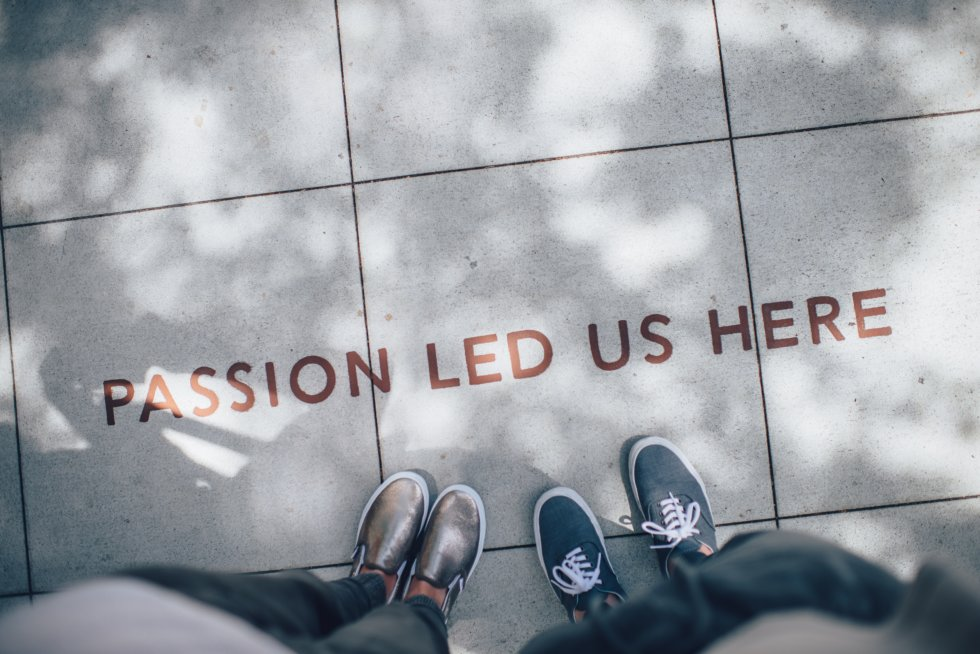 Passion led us here wrote on grey tiles